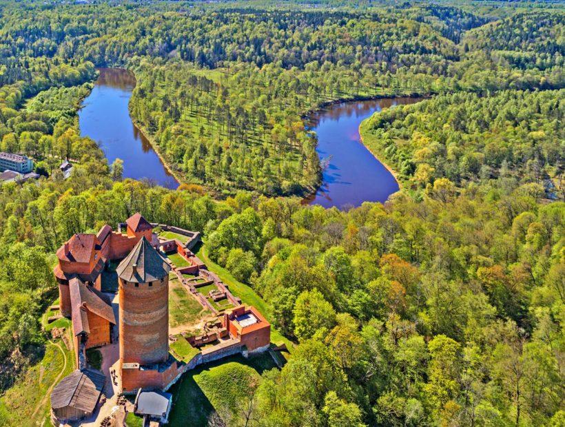 Beautiful aerial view of medieval Turaida castle at Gauja river valley, Sigulda, Latvia